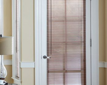 french doors with faux wood blinds